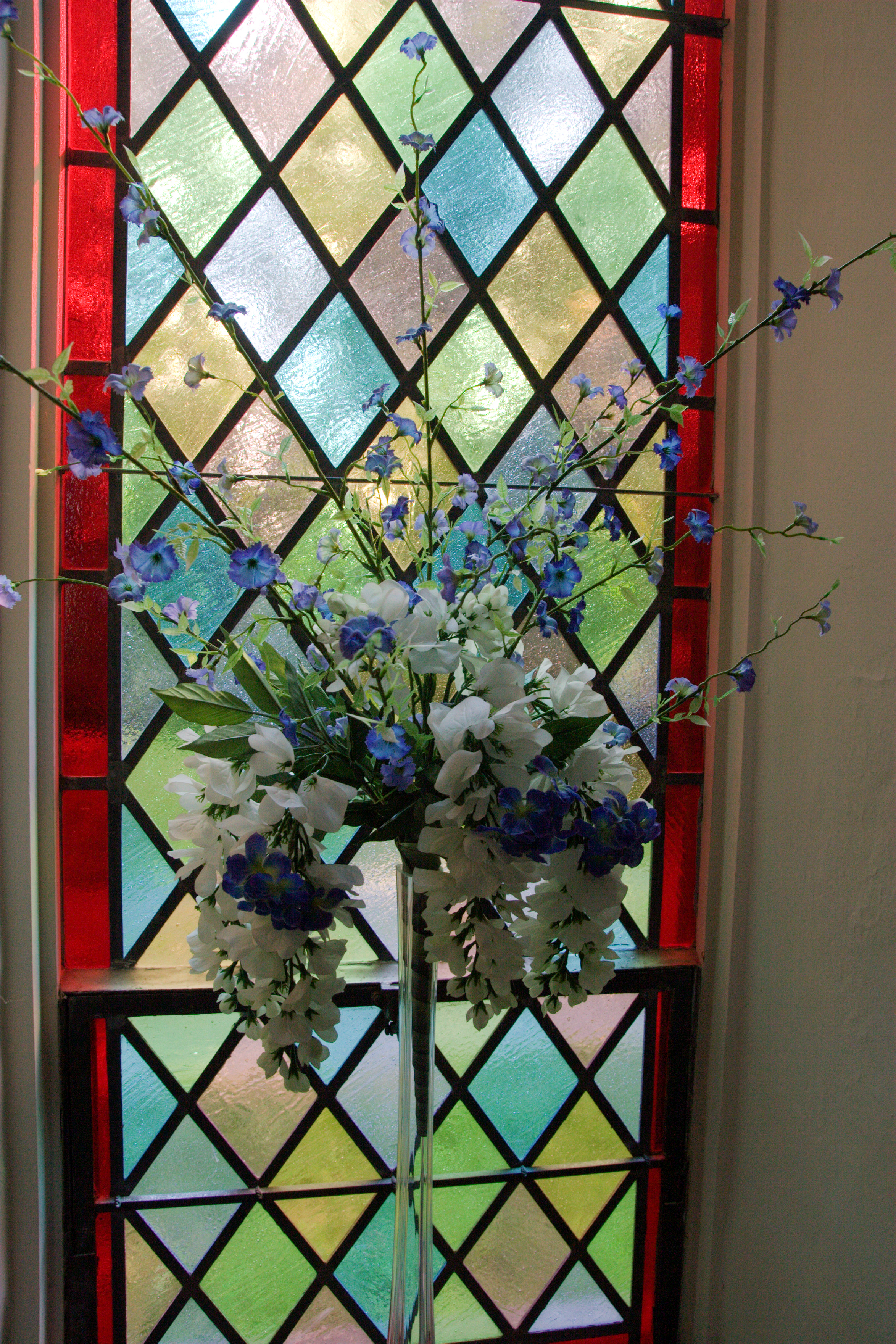 Flowers in front of window