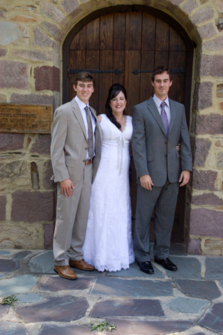 Bride and brothers at church door