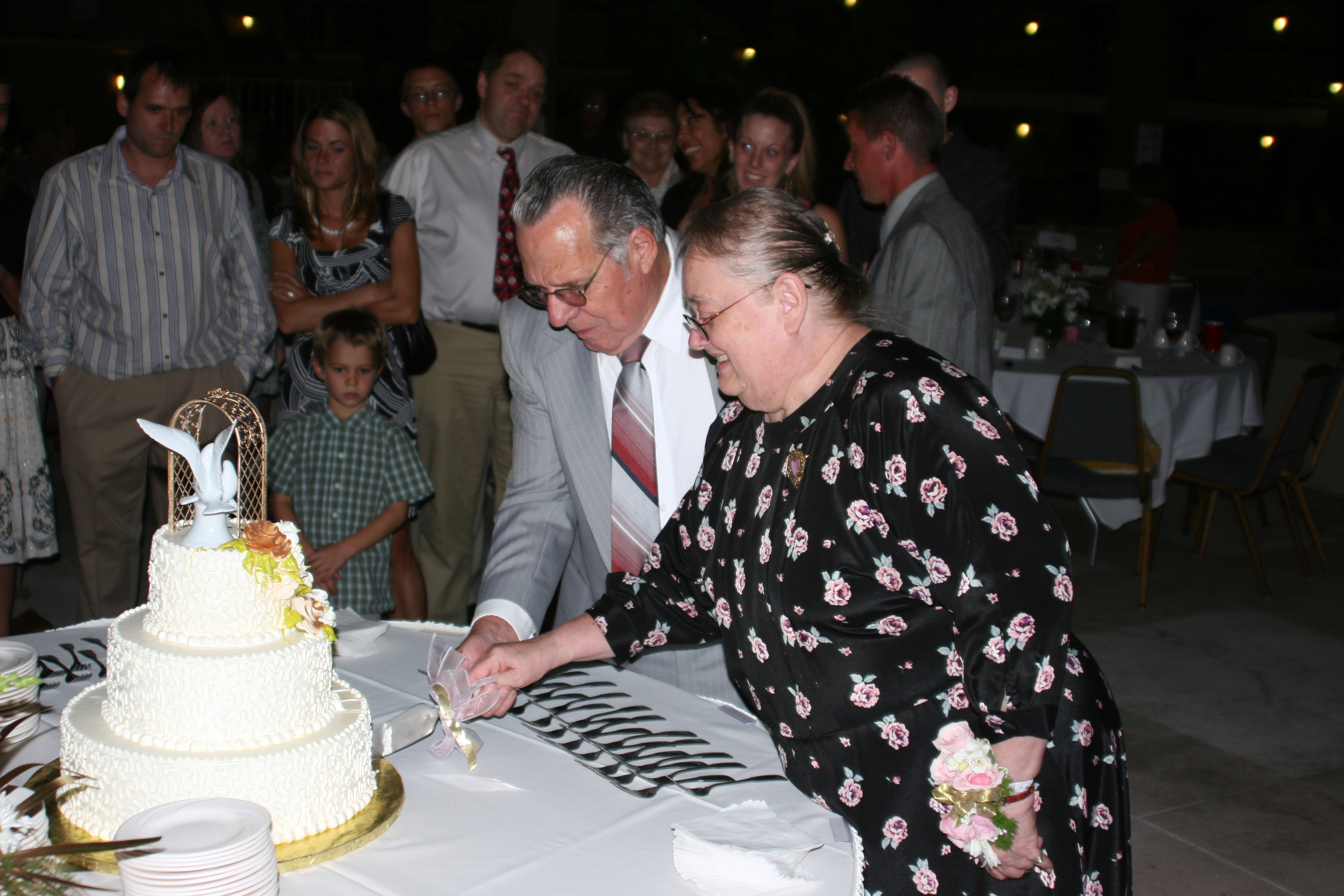 cutting cake 50th anniversary