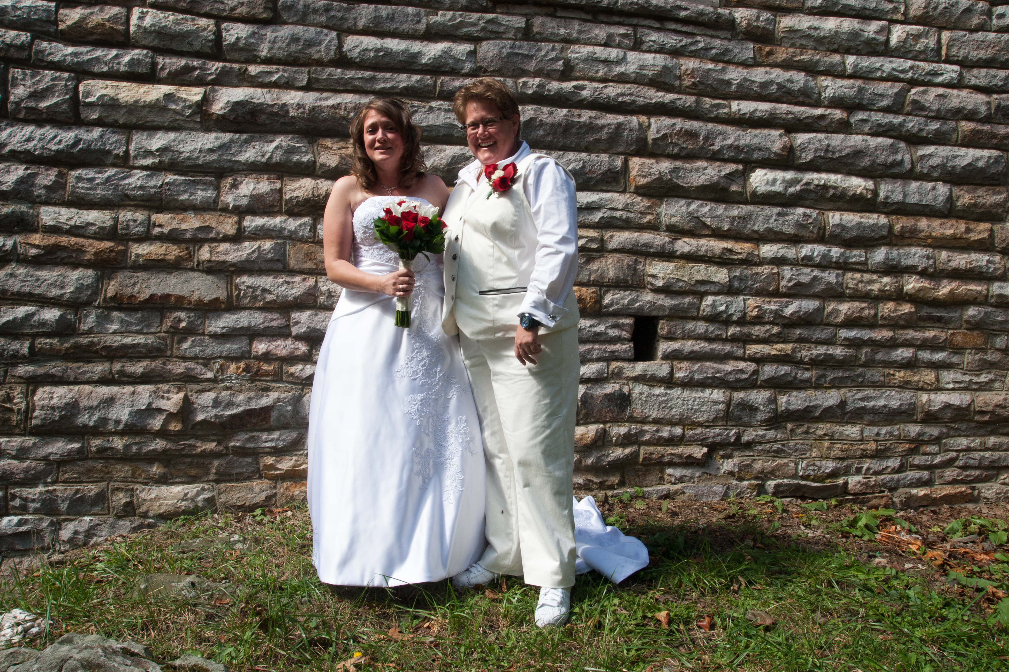 Couple with stone wall background