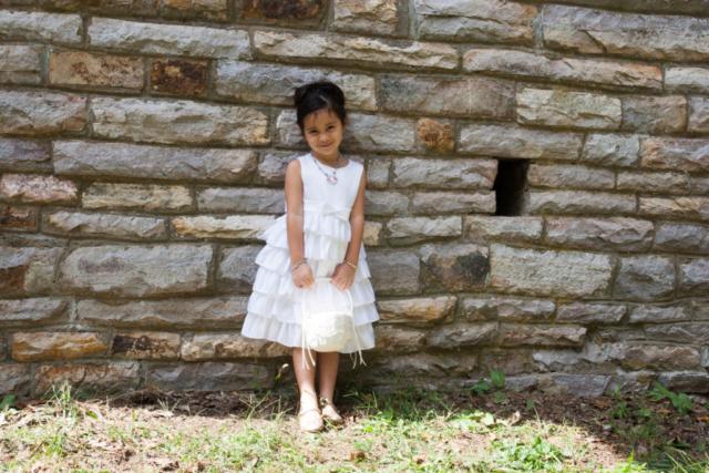 Flower girl against stone wall