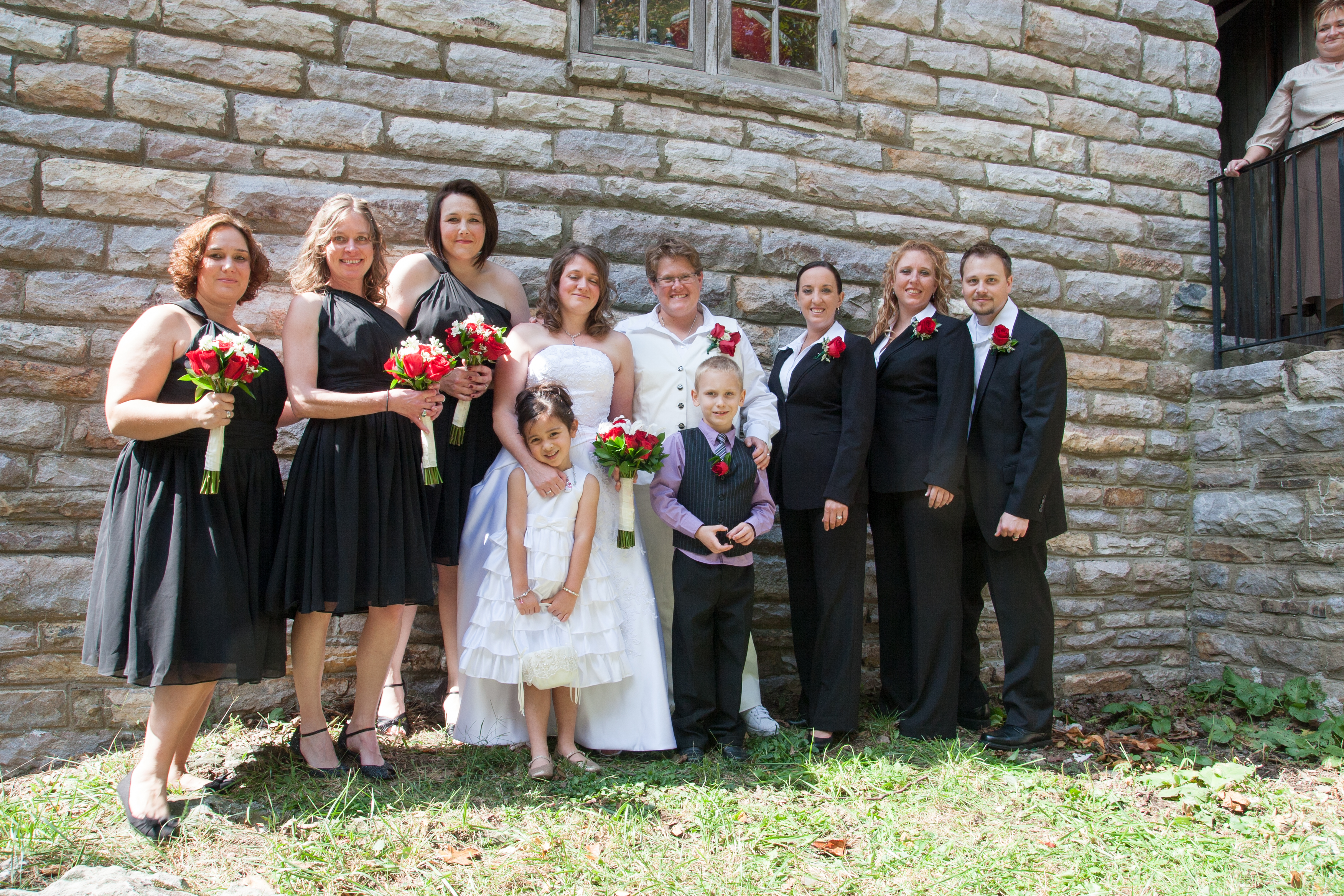 Wedding Party with stone wall