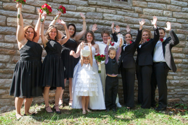 Wedding Party with Raised Hands