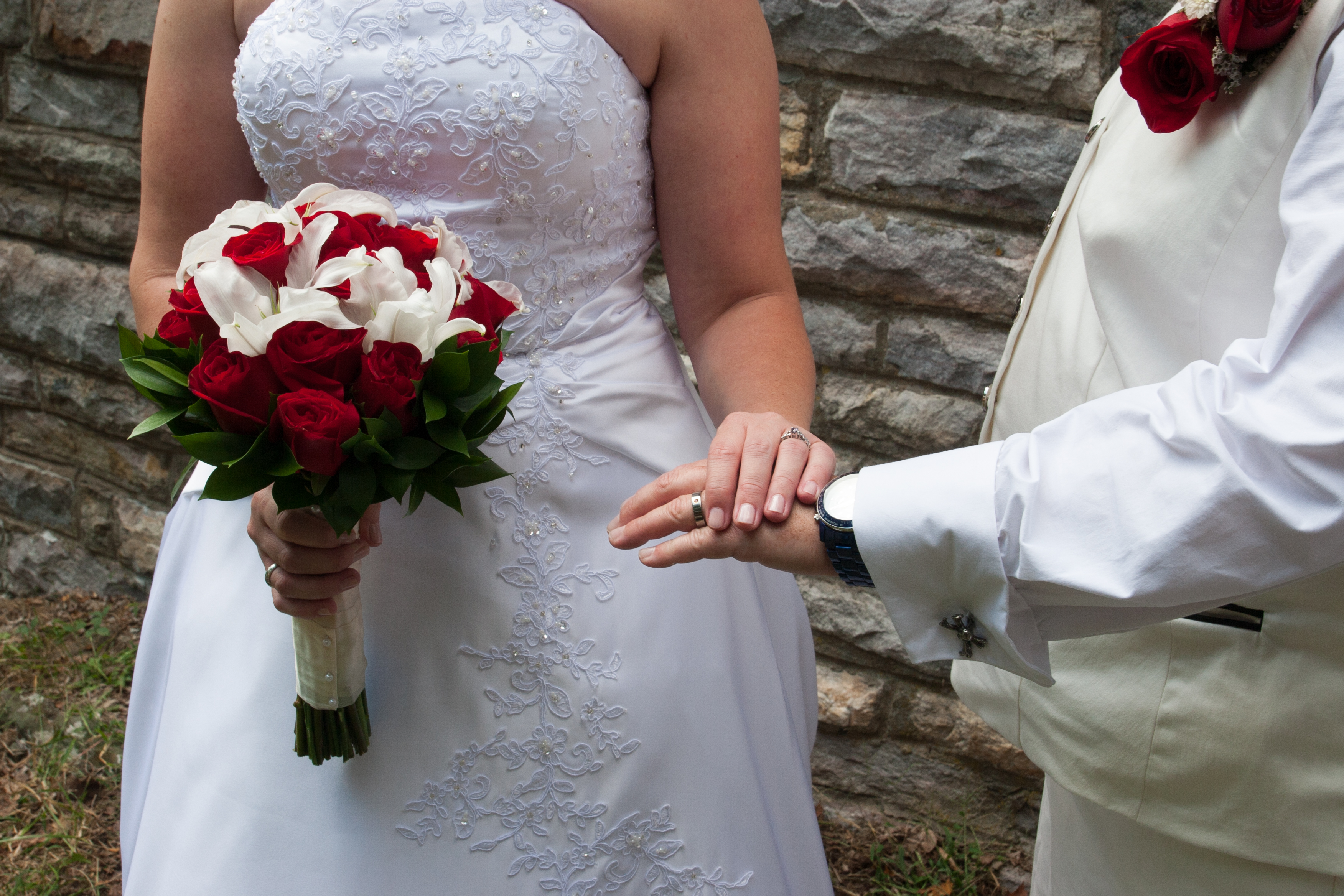 Couple displays wedding rings