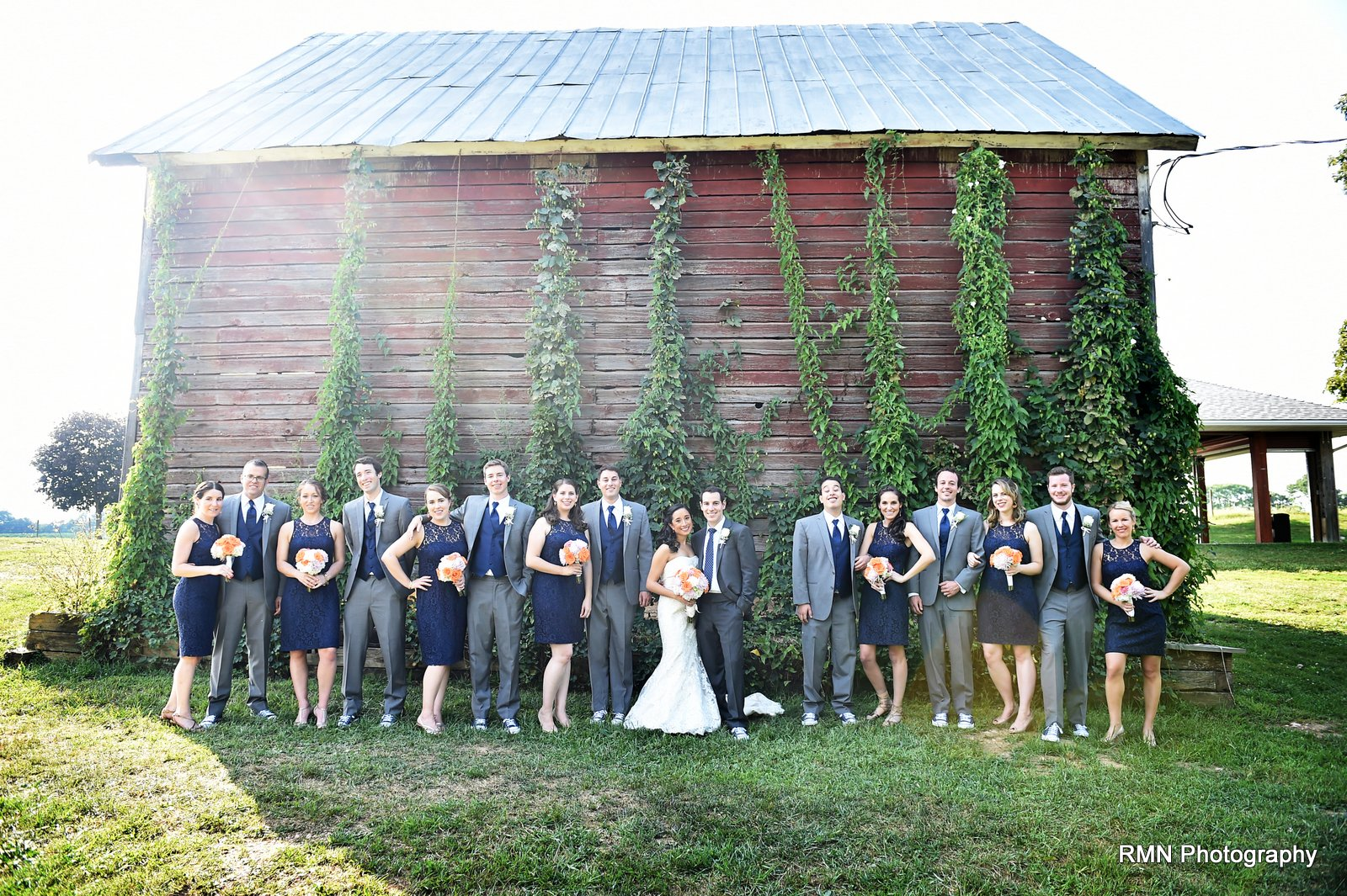 Wedding party by barn