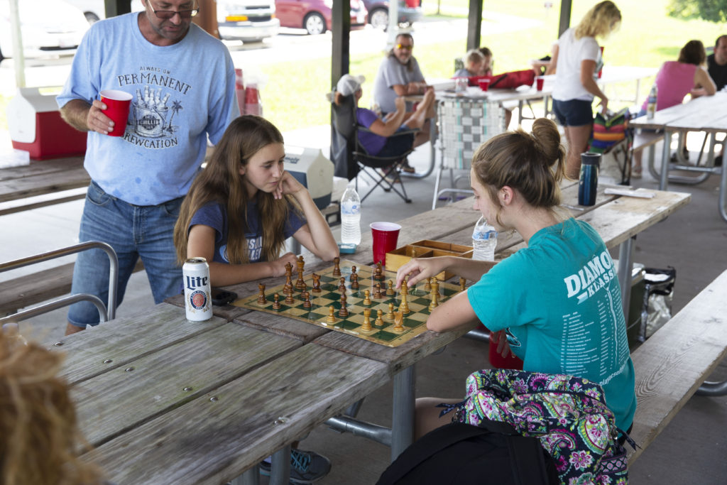 Children playing table games at a family reunion